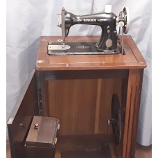 Singer 66k reconditioned treadle operated in cabinet
